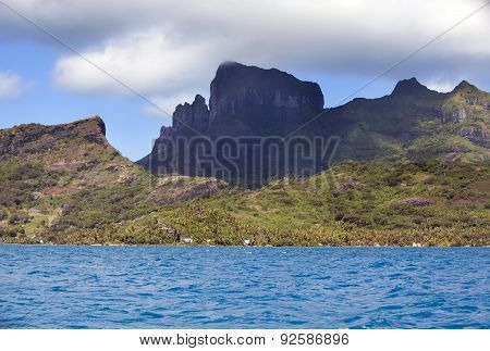 Bora Bora Polynesia. Mountains the sea palm trees