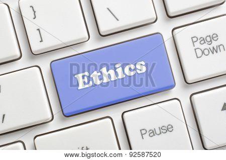 Blue ethics key on keyboard