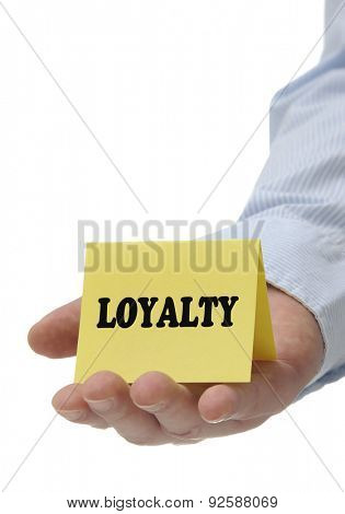 Business man holding yellow loyalty sign on hand
