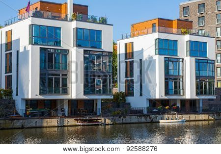 Two modern houses at the water