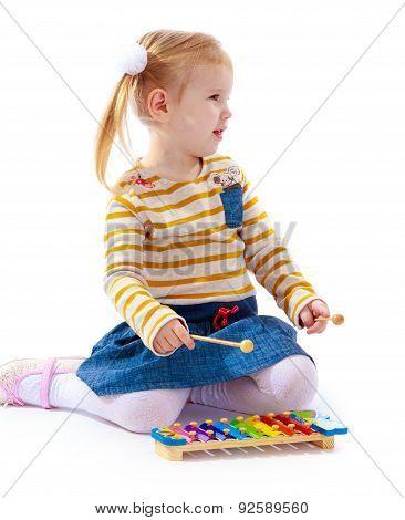Blond little girl sitting