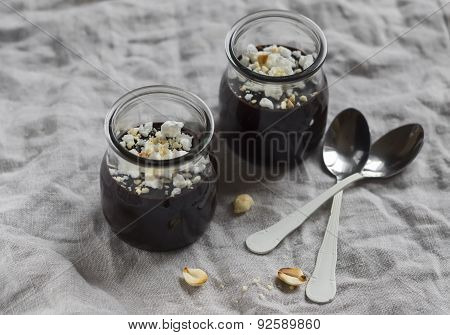 Chocolate Pudding With Nuts On A Grey Surface