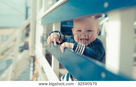 Little baby girl laughing on a beach house