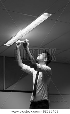 electrician changing the light in the office