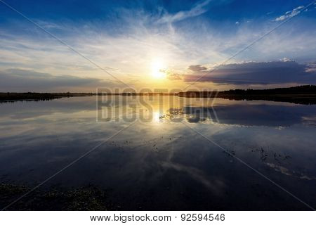 Evening landscape with nice sunset on lake