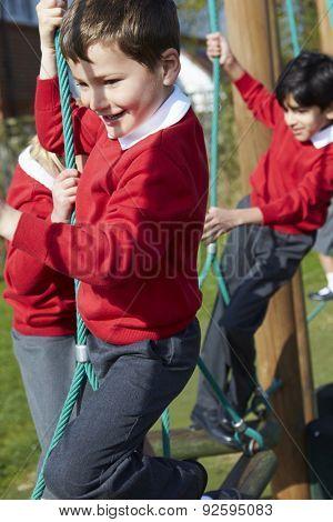 Elementary School Pupils On Climbing Equipment