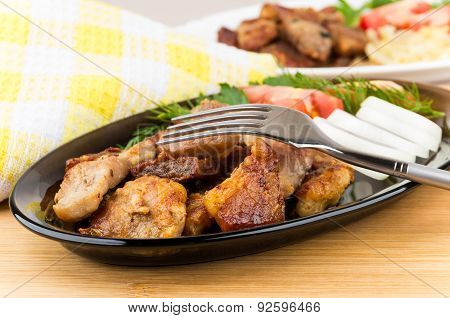 Roast Pork With Herbs And Vegetables In Platter, Fork