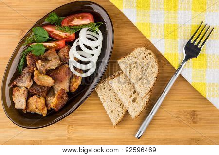 Roast Pork With Herbs And Vegetables In Platter, Bread, Fork