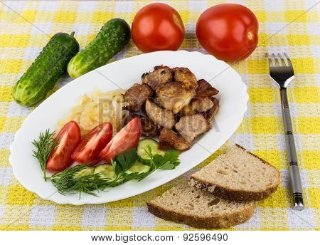 Roast Pork With Herbs And Vegetables In Platter