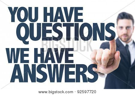 Business man pointing the text: You Have Questions We Have Answers