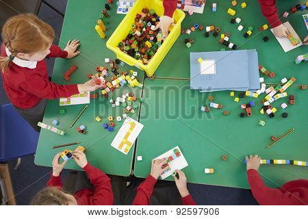 Overhead View Of Pupils Working With Coloured Blocks