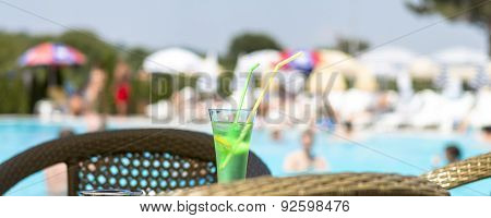 Idyll Relaxation With Cold Drink Next To The Swimming Pool