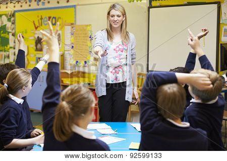 Teacher Teaching Lesson To Elementary School Pupils