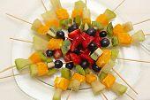 stock photo of fruit platter  - Fresh Fruits On Skewers Sticks For Party - JPG