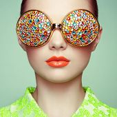 image of jewelry  - Portrait of beautiful young woman with colored glasses - JPG