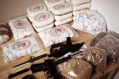 picture of drug dealer  - Drug packages raw opium drug dozens and weapons seized by police - JPG
