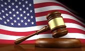 picture of justice  - USA law and justice of The United States of America concept with a 3d render of a gavel on a wooden desktop and the flag of US on background - JPG