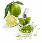 stock photo of lime  - Lime with leaves lime zest with zester isolated on a white background - JPG