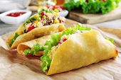 picture of tacos  - Tasty taco with vegetables on paper on table close up - JPG
