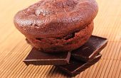 pic of chocolate muffin  - Homemade delicious fresh baked chocolate muffins lying on pieces of chocolate - JPG
