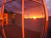 picture of premises  - Cityscape at sunset which is reflected in the window of an empty shop premises with wide angle fisheye lens and distortion view - JPG