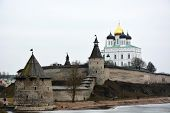 foto of fortified wall  - Stone tower and Pskov Kremlin fortress wall at the confluence of two rivers - JPG