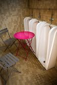 foto of urine  - Table and garden chairs in a urinal - JPG