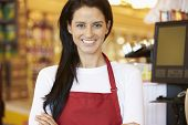 pic of cashiers  - Female Cashier At Supermarket Checkout - JPG