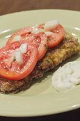 foto of cod  - Breaded cod fillet with tomato and onion with tartar sauce - JPG