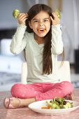image of fussy  - Girl Making Devil Face With Plate Of Fresh Vegetables - JPG