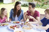picture of 11 year old  - Family Enjoying Outdoor Meal Together - JPG