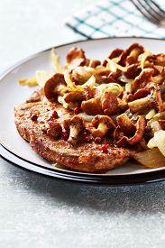 foto of chanterelle mushroom  - Pork steak with chanterelle mushrooms - JPG