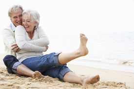 pic of couple  - Senior Couple Sitting On Beach Together - JPG