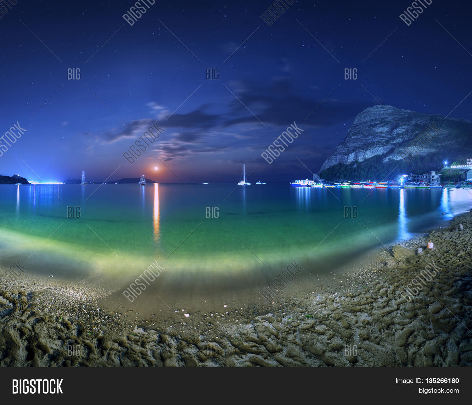 Beautiful Night Landscape At The Seashore With Yellow Sand Full Moon Mountains And Lunar Path