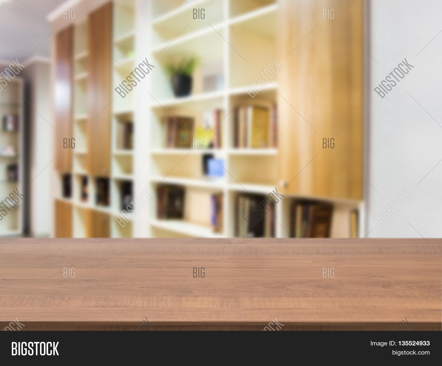 Empty wood table and blurred living room background stock photo - Wooden Board Empty Table In Front Of Blurred Background Perspective Dark Wood Over Blur In