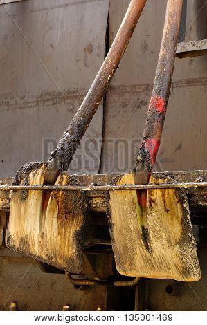 Shovels asphalt tools objects still life industries theme.