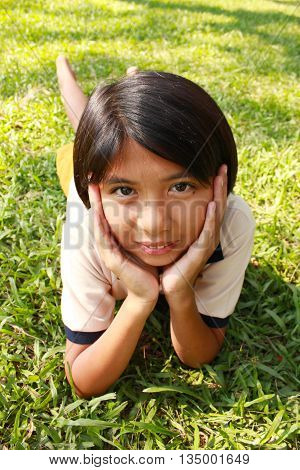 Portrait of young girl having a good time in the park