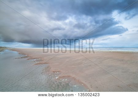 North sea beach at low tide Holland