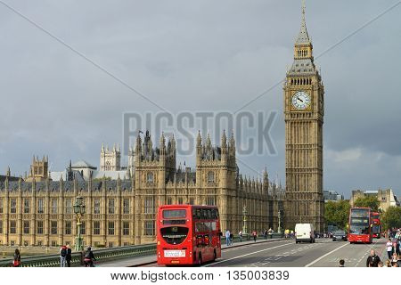 LONDON - OCTOBER 04: London bus crossing Westminster Bridge near Parliament on October 04 2014 in London UK. London is one of the world's leading tourism destinations