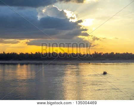 idyllic scenery at Mekong river in Laos at evening time