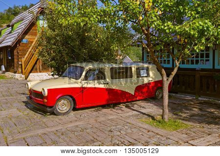 DRVENGRAD, SERBIA - SEPTEMBER 03: Retro cars in traditional village Drvengrad Mecavnik on September 03, 2015 in Drvengrad, Serbia.