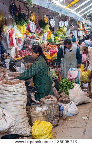 CUSCO PERU - CIRCA MARCH 2015: Unidentified people at the market in Cusco Peru