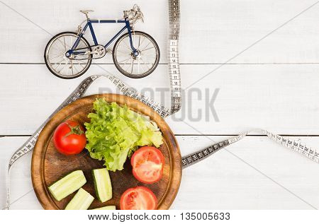Sport And Diet Concept -  Bicycle Model, Fresh Vegetables And Centimeter Tape