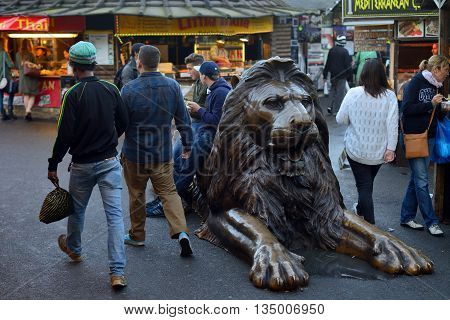 LONDON - OCTOBER 04: Lion Sculpture in Camden Town market on October 04 2014 in London UK. Camden Town markets are visited by 100000 people each weekend