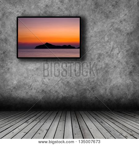 Plasma TV on the wall of the room with wooden floor