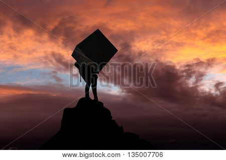 Businessman carrying heavy package - concept of tough career in the business