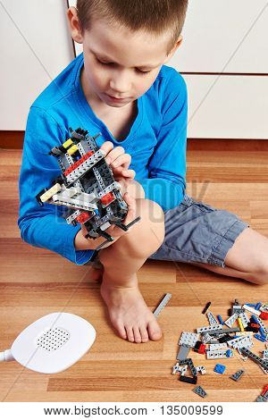 Child Collects Plastic Toy Building Kit