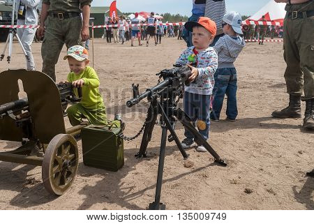 Tyumen Russia - June 11 2016: Race of Heroes project on the ground of the highest military and engineering school. Exhibition of weapon. The boy considers an easel machine gun