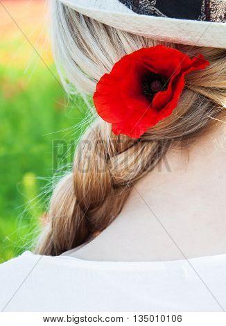 Poppy Flower In The Girl's Hair