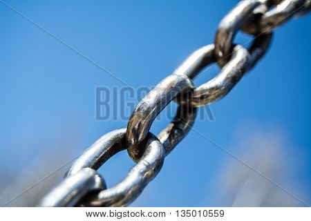 diagonal steel chain on the blue sky background
